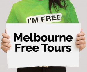 I'm Free Melbourne Tours guide holding free tours sign. Click to find out more about Melbourne tours