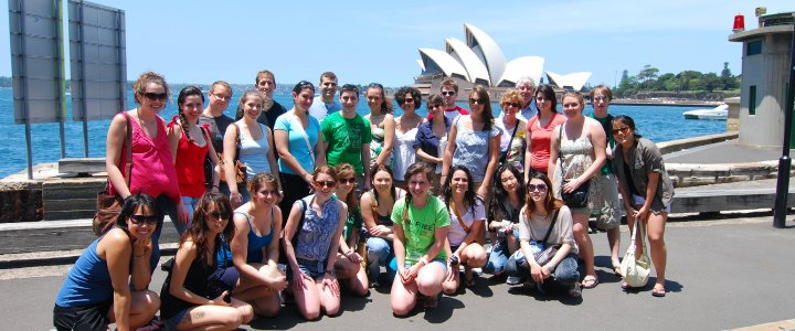 Private Walking Tour group with their own personal guide in front of the Sydney Opera House.