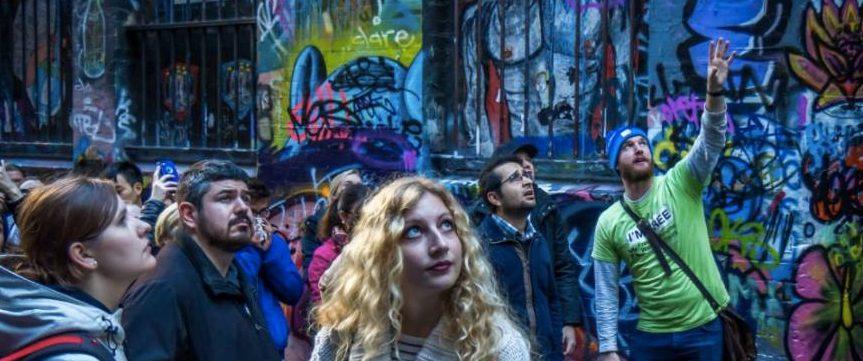 Melbourne Hidden Culture Free Walking Tour Group looking at Melbourne street art laneway