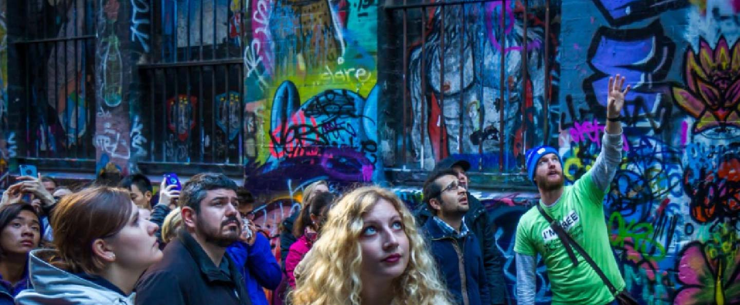 Culture Capital local tour guide showing street art in a Melbourne Laneway